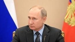 Журнал Time поместил Владимира Путина наобложку