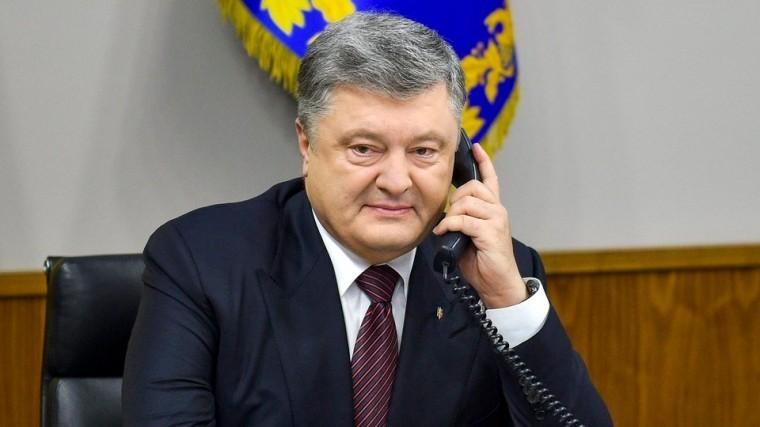 Фото: «Параноидальный» Порошенко вывесил вцентре Харькова портрет Путина
