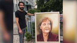 Видео: пытавшегося подарить Меркель портрет мужчину полиция приняла запикетчика