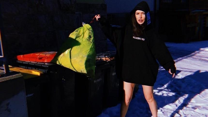 Фото: Ольга Серябкина без штанов инашпильках позирует нафоне мусорных баков