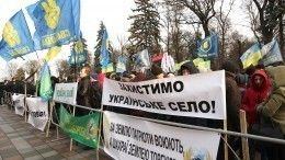 Массовые протесты против принятия закона опродаже земли проходят вКиеве