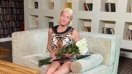 Волочкова рухнула нафотосессии из-за длинного платья