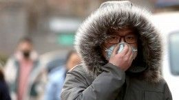 ВКитае придумали замену рукопожатию нафоне эпидемии коронавируса?