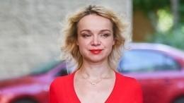 «Показуха»: Цымбалюк-Романовская под камерами прибралась намогиле Джигарханяна