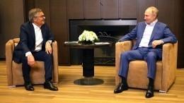 Путин провел беседу сглавой IIHF нанемецком языке
