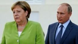 Путин обратил внимание Меркель наукраинский закон окоренных народах